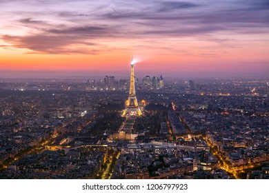 PARIS, FRANCE - 9 Oct 2018: Panoramic view of Paris from Montparnasse tower with the illuminated Eiffel tower in the center during picturesque sunset