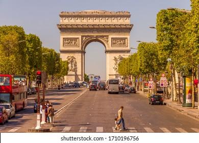 Paris, France - 9 September, 2012:  The Champs-Élysées and the Arc de Triomphe. The most famous avenue of Paris has 1910m and is full of stores, cafés and restaurants.