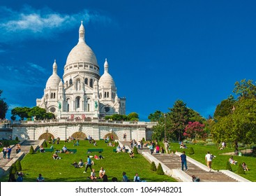 PARIS, FRANCE - 9 SEPTEMBER 2014: Sacre Coeur Cathedral on Montmartre on 9 September 2014 in Paris, France. It is a Roman Catholic church and minor basilica, dedicated to the Sacred Heart of Jesus.