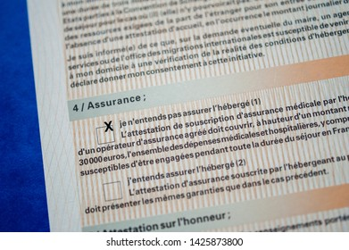 Paris, France - Apr 10, 2013: Detail of Attestation d'accueil Proof of Accommodation for visitors from other countries to France marked - visitor is responsible for healthcare insurance