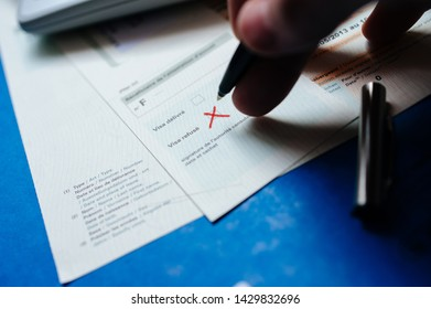 Paris, France - Apr 10, 2013: Man hand filling Attestation d'accueil Proof of Accommodation for visitors from other countries to France with visa refused