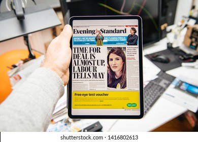 Paris, France - Apr 15, 2019: Man reading on iPad Pro Apple News Plus digital newspaper Evening Standard featuring on cover about Brexit Deals