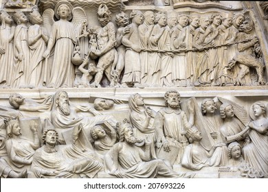 PARIS, FRANCE - APR 23,2014: architectural detail of Notre Dame cathedral.Detail of central portal, depicting the Last Judgment (c.1230).
