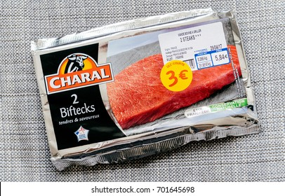 PARIS, FRANCE - APR 29, 2017: Biftecks packaged in protective packaging made by the French meat producer Charal with special price of 3 Euros instead of 5  Euro. Charal is part of the groupe Bigard.