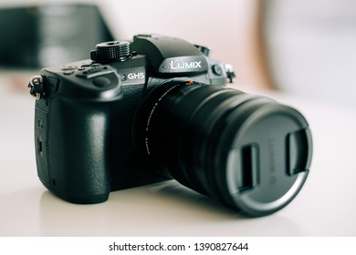 Paris, France - Apr 5, 2017: Side view of Panasonic Lumix GH5 mirrorless camera capable of doing 10bit video internally on sd card isolated on white background