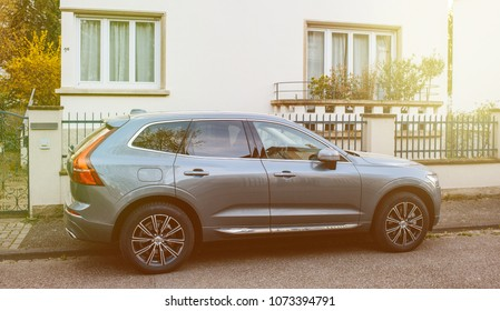 PARIS, FRANCE APR 8, 2018: Side view of luxury Volvo XC60 SUV parked on a French calm street. Volvo. New XC60 is the car of the Year