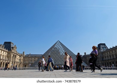 PARIS, FRANCE - APRIL 07, 2017: Tourists in the courtyard outside the Louvre art museum