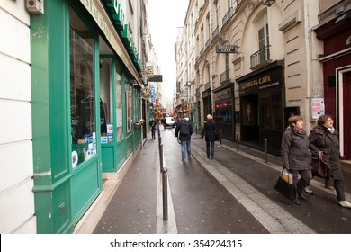 PARIS, FRANCE - APRIL 09, 2013: Paris streets. City of Love IN France. Street of Paris. Spring in Paris.Paris architecture: Old narrow street of Paris, Europe