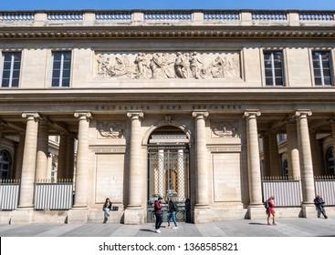 Paris, France - April 11, 2019: People passing along Rene Descartes medical university in Quartier Latin.