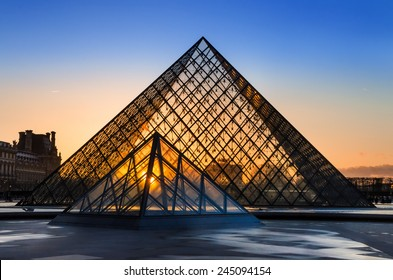 PARIS, FRANCE - APRIL 12: The Louvre and pyramid during  sunset on april 12, 2013 in Paris, France.
