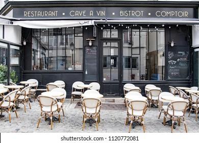 PARIS, FRANCE - APRIL 13, 2018: The black exterior of the cafe restaurant