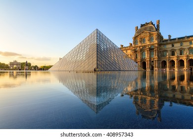 PARIS, FRANCE - APRIL 14, 2014: The Louvre museum pyramid at sunset in Paris, France, on April 14, 2014