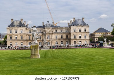 PARIS, FRANCE - APRIL 14, 2017: Tourists and Parisians relaxing in Luxembourg Garden (Jardin du Luxembourg). Jardin du Luxembourg - second largest Public Park in Paris. Park is garden of French Senate