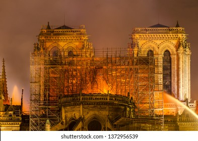 Paris, France;  April 15 2019: Fire in Notre Dame Cathedral registered on April 15, 2019. With a view from the back of the cathedral while the fire was not extinguished at night.