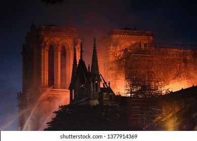 PARIS, FRANCE - April, 15 2019 :  The monument of Paris, the cathedral of Notre Dame de Paris on fire during the fire that started in the attic during works on the roof.