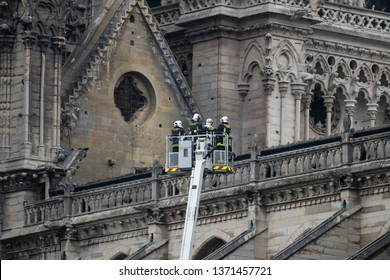 PARIS, FRANCE - April, 16 2019 :  Firefighters inspect the structure of the building, the cathedral Notre Dame, after the fire during the fire that started in the attic during works on the roof.