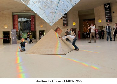 PARIS, FRANCE -APRIL 17, 2010: The Inverted Pyramid with the rainbow reflection underground of the Louvre museum