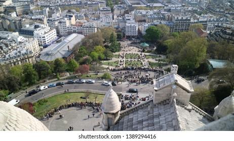 Paris, France - April 18, 2019: View of Place du Tertre in Montmartre Paris from the famous Sacre Coeur - La Basilique du Sacré Cœur de Montmartre