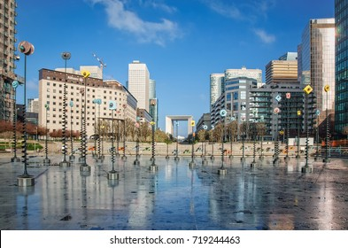 Paris, France - April 20, 2013: View of Le Bassin, Takis installation and modern architecture buildings in Paris La Defense business district.