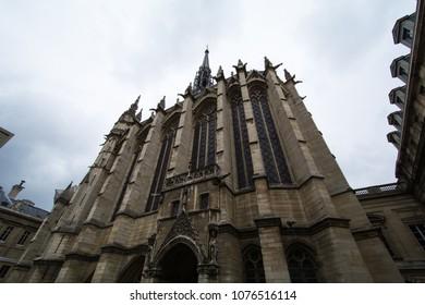 Paris, France - April, 2018: building of Sainte-Chapelle chapel against blue sky and cloud in Paris.