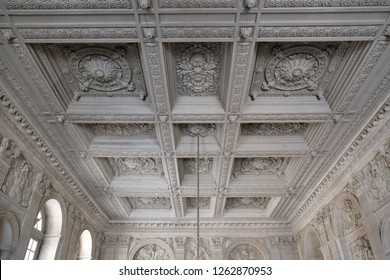 Paris, France - April 21, 2018: Coffered ceiling made of white marble in Versailles