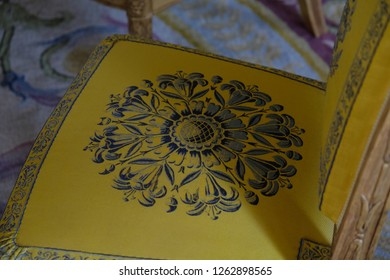 Paris, France - April 21, 2018: Ornament on a chair in apartaments of Louis Philippe in the Grand Trianon