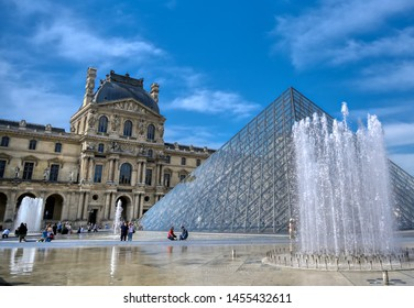 Paris, France - April 21, 2019 - A view of the Louvre Museum, the world's largest art museum and a historic monument in Paris, France, on a sunny day.