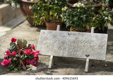 PARIS, FRANCE - APRIL 22, 2016: Serge Gainsbourg's grave in the cemetery of Montparnasse. Serge Gainsbourg was a French singer, songwriter, pianist,  poet, painter, writer, actor, and director.