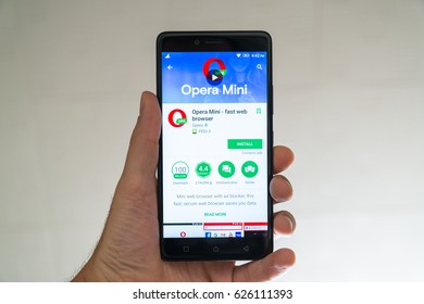 Paris, France, april 22, 2017: Opera mini application on google play store on smartphone