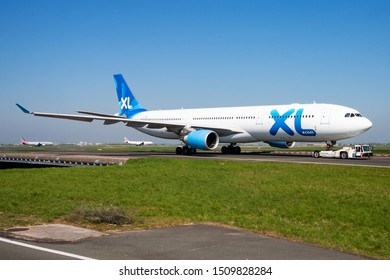 Paris / France - April 23, 2015: XL Airways France Airbus A330-300 F-HXLF passenger plane taxiing at Paris Charles de Gaulle Airport