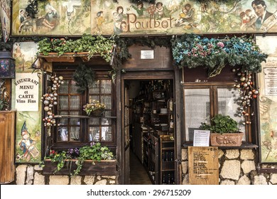 PARIS, FRANCE - APRIL 23, 2015: View of typical cafe in Paris. Montmartre area is most popular destinations in Paris, has lots of cozy cafes, restaurants, bistros, night clubs and artistic studios.