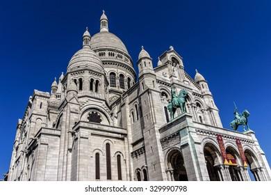 PARIS, FRANCE - APRIL 23, 2015: View of Basilica Sacre Coeur (designed by Paul Abadie, 1914) - Roman Catholic Church and minor basilica, dedicated to Sacred Heart of Jesus.