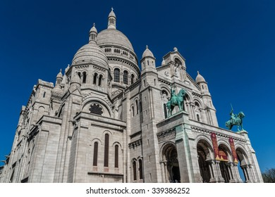 PARIS, FRANCE - APRIL 23, 2015: View of Basilica Sacre Coeur (designed by Paul Abadie, 1914) - Roman Catholic Church and minor basilica, dedicated to Sacred Heart of Jesus.