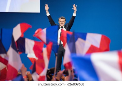 PARIS, FRANCE - APRIL 23, 2017 : Emmanuel Macron celebrate his first place in the first round of the french presidential election, at Paris Porte de Versailles with his political party en marche.