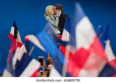 PARIS, FRANCE - APRIL 23, 2017 : Emmanuel Macron kissing his wife Brigitte, to celebrate his first place in the first round of the french presidential election with his political party en marche.