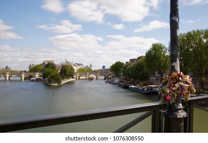 Paris, France - April 23, 2018: Love padlocks, lockers, locks on Pont des Arts bridge, Seine river in Paris