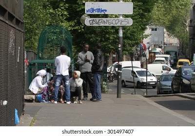 PARIS, FRANCE - April 24: A group of young people in the streets of the multi-racial area of the 19th Arrondissement of Paris, France on the 24th April, 2015.
