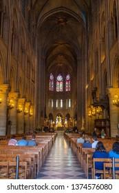 PARIS, FRANCE - APRIL 25: People attend morning service in Notre Dame cathedral on April 25, 2011 in Paris, France. Notre Dame de Paris receives about 12 million visitors annually.