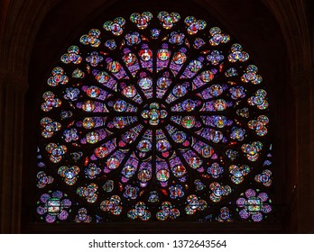 PARIS, FRANCE - APRIL 25: Stained glass window in Cathedral Notre Dame de Paris on april 25, 2011 in Paris. Notre Dame de Paris is UNESCO World Heritage Site.