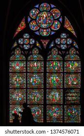 PARIS, FRANCE - APRIL 25: Stained glass window in Cathedral Notre Dame de Paris on april 25, 2011 in Paris. Notre Dame de Paris is UNESCO World Heritage Site.
