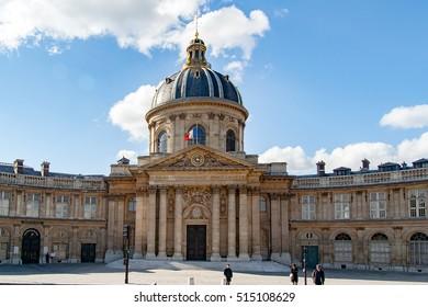 PARIS, FRANCE - april 26, 2016: Pedestrians cross the Ponts des Arts to Bibliotheque Mazarine in Paris.