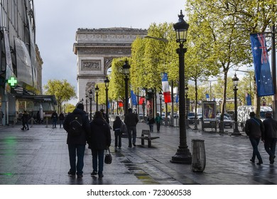Paris, France - April 26, 2016 - People walking in Paris around the The Arc de Triomphe