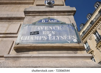 Paris, France - April 26, 2016 - Avenue des Champs Elysees sign in Paris with a building and the sky in the back