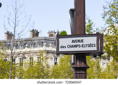 Paris, France - April 26, 2016 - Avenue des Champs Elysees sign in Paris with a building and trees in the back