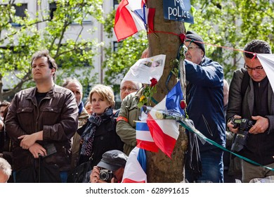 Paris, France - April 26, 2017 : Police officers paying tribute to Xavier Jugelé, officer killed on Champs-Elysées by Daesh few days before.