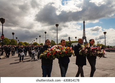 Paris, France - April 26, 2017 : Police officers protesting during the protest march against cuts and in tribute to Xavier Jugele, officer killed on Champs-Elysees by Daesh few days before.