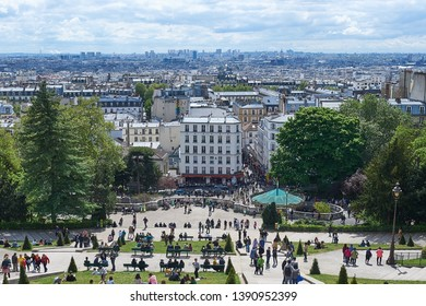 Paris, France, April 26 2019: Paris view from Montmartre. Montmartre is a popular touristic destination in Paris. It is a large hill which allows to enjoy a beautiful view of the city.