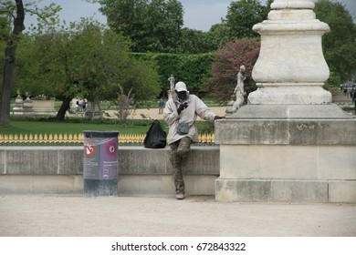 PARIS, FRANCE: APRIL 26: An illegal immigrant touting outside the Louvre in Paris, France on the 26th April, 2015.