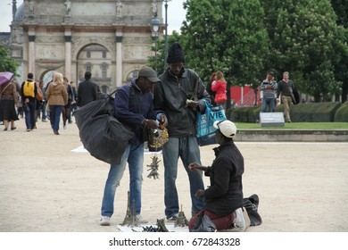 PARIS, FRANCE: APRIL 26: Illegal immigrants touting outside the Louvre in Paris, France on the 26th April, 2015.