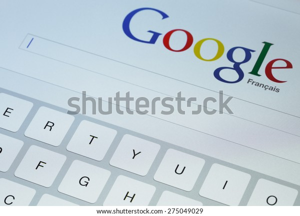 Paris, France - April 27, 2015: Google search page on screen of ipad